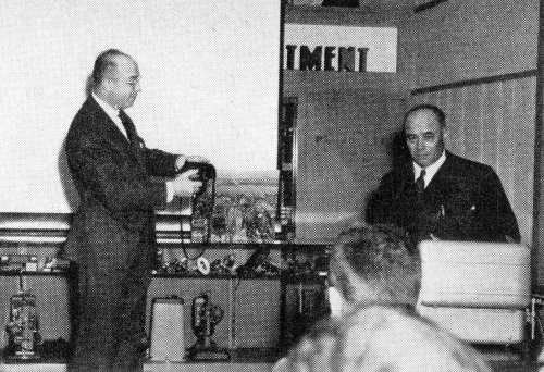 Rudolph Simmon (left) demonstrates the Omega 120 at the MPDFA Chicago, March 1954